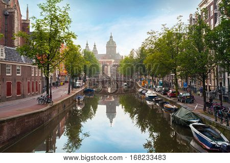 Houses and Boats on Amsterdam Canal. Morning photo of colored houses in the Dutch style with reflection in water