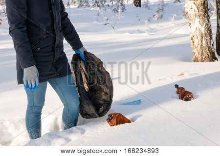 Girl With A Garbage Bag In The Winter Forest