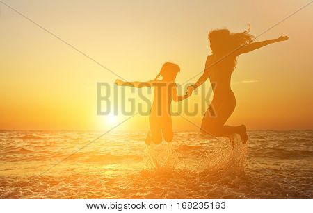 mother and daughter having fun at the seaside. vacation at the seaside