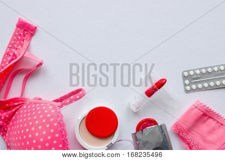 Underwear Women, Cosmetics And Contraceptives On A White Background