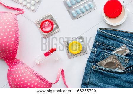 Clothing And Contraceptives On A White Background