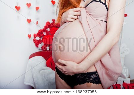 Image of pregnant woman touching her big belly. Close up. Motherhood, pregnancy, people and expectation concept. Pregnant woman expecting baby.
