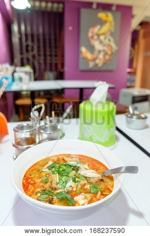 Thai cuisine Tom Yum soup with seafood hot and spicy clear soup is typical for Thailand.