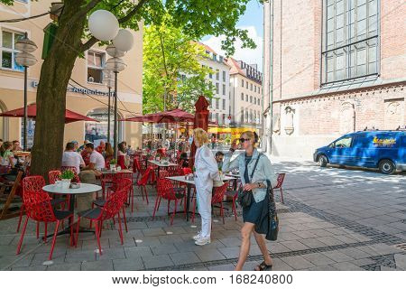 MUNICH, GERMANY-July 4, 2016: Street view of Tourists on foot Street in Downtown Munich on July 4, 2016, in Munich, Germany.