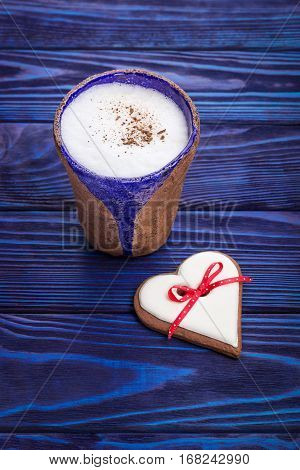Homemade coffee latte with true ceylon cinnamon and gingerbread heart. Happy Valentine's Day