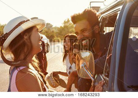 Friends on a road trip make a stop in their camper van