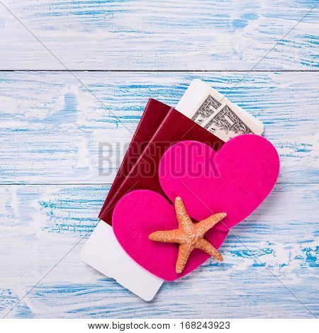 Tropical Honeymoon. Passports With Boarding Pass, Dollar Banknotes And Heart Shapes On Rustic Wooden