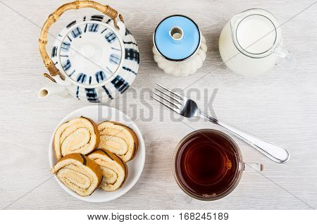 Swiss Roll Cake In Saucer, Tea, Sugar, Jug Milk