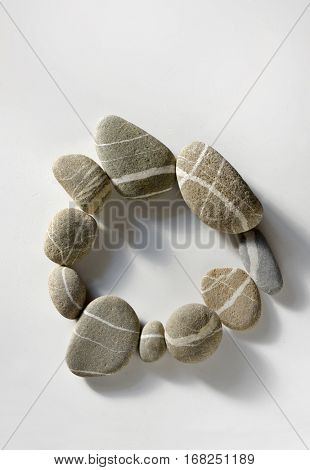 Pebble circle in stone on white background