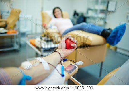 Donor of blood gripping hand-flexor