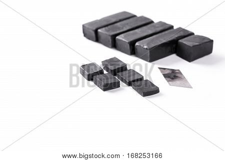 Blocks of hashish on white background. Closeup