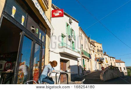 October 3, 2016, Boujan Sur Libron, France Woman at cafe table outside Boujan Sur Libron France