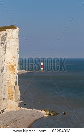 Closeup of the cliff at Beachy Head in Sussex and the lighthouse just beside on a bright sunny summer's day.
