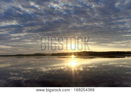 View Of The Golden Sunset On The River With Clouds And The Sun Reflected In It, Volga, Russia