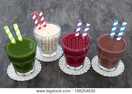 Health food drinks of wheat grass, maca root, acai berry and chocolate whey. Also used by body builders.