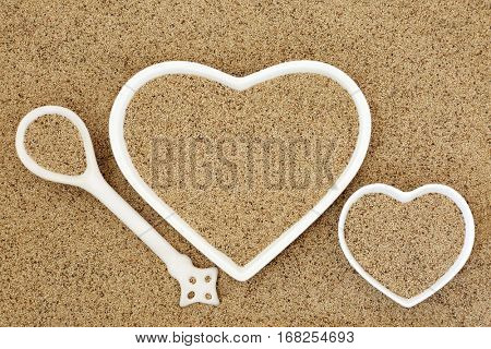 Teff super grain health food in heart shaped porcelain dishes and spoon forming a background.