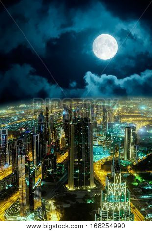 Dubai night aerial cityscape view with full moon