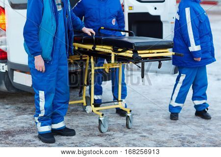 Emergency ambulance workers with stretcher