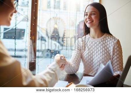 Female agent greeting new candidate after interview