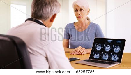 Older Woman Talking With Personal Doctor About Her Health Concerns