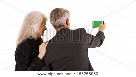 Senior Couple Using Smartphone With Green Screen On White Background