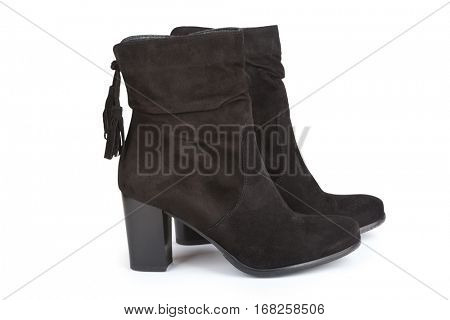 Black ankle boots with a tassel isolated on white (with shadow)