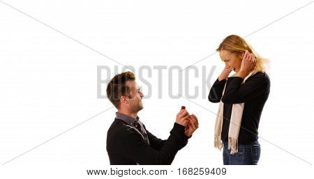 Young White Man Proposes To His Girlfriend In Front Of White Background
