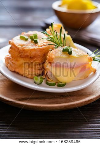 Fried Onion Slices In Batter, Stuffed With Ham And Cheese