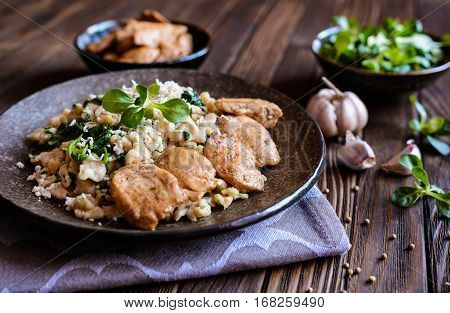 Fried Chicken Meat With Spelt Flour Dumplings And Spinach