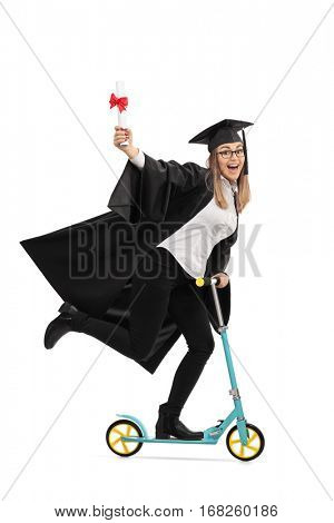 Full length portrait of an overjoyed graduate student holding a diploma and riding a scooter isolated on white background