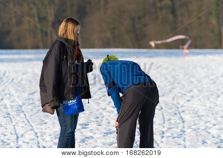 OLDENZAAL NETHERLANDS - JANUARY 22 2017: Unknown exhausted athlete takes a breath during a cross run in a snow white landscape