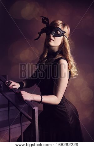 beautiful girl in black mask