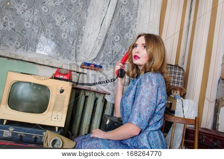 portrait of beautiful blonde woman in soviet union interior.