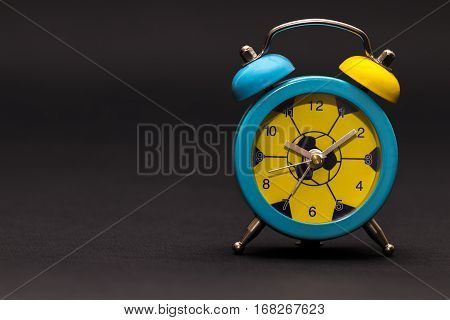 Alarm Clock On Black Background.