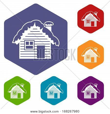 Wooden house covered with snow icons set rhombus in different colors isolated on white background