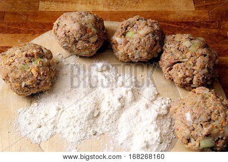 Rissoles, Made From Minced Meat, Onion And Breadcrumbs, Ready To Be Rolled In Flour And Fried