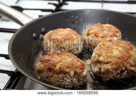 Rissoles, Made From Minced Meat, Onion And Breadcrumbs, Frying In A Pan
