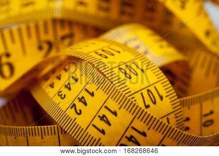Sewing textile or cloth. Work table of a tailor. Measuring tape on textile shallow depth of field.