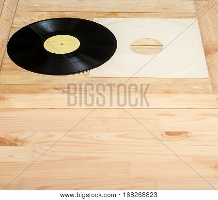 Vinyl record with copy space in front of a collection of albums dummy titles vintage process