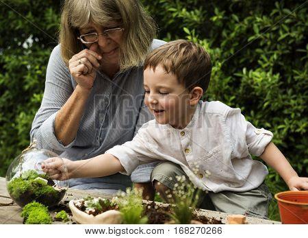 Granny Plants Outside Kid Boy