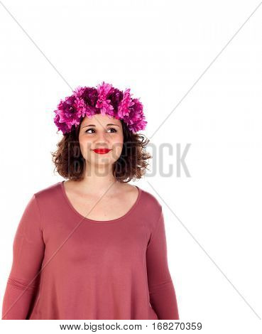 Pensive curvy girl with a flowered headdress isolated on a white background