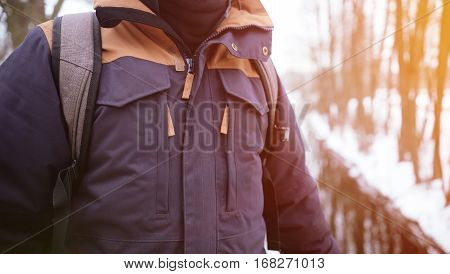 Man in jacket on sunny natural background. Close up of body in jacket outdoors. Nice travel concept.