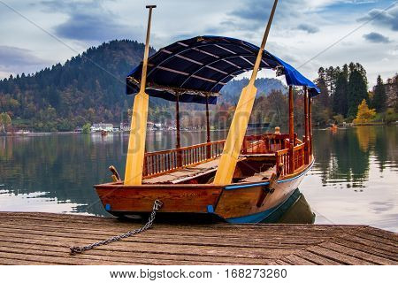 A pletna traditional Slovenia boat on Lake Bled with Bled Castle in the background