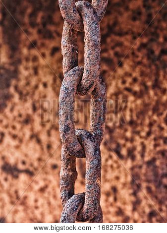 Close up links from a rusty metal chain