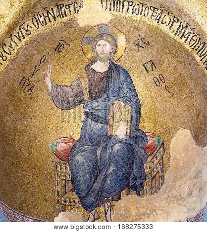 Byzantine Mosaic of Christ pantocrator sitting on a throne Pammakaristos church in Istanbul Tyrkey - October 11, 2013