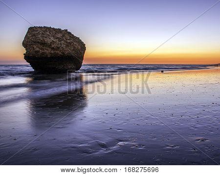 Sunset in the beach Matalascañas. Huelva, Andalusia, Spain.