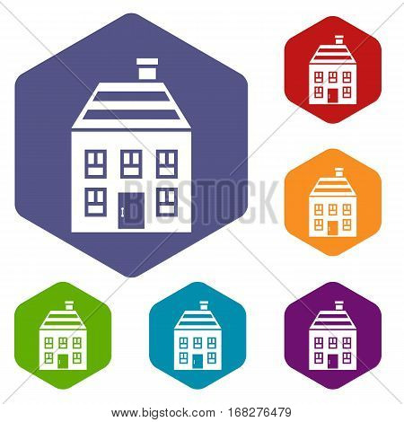 Two-storey house with chimney icons set rhombus in different colors isolated on white background