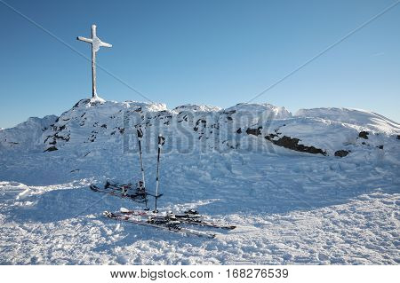 wooden cross on top of a mountain Maple covered with big frost. Grosser Arber Bayerisch Eisenstein Germany. Winter snowy summit of Mt. Grosser Arber at Bavarian Forest (Germany).