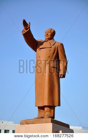 SHENYANG, CHINA - JUL. 26, 2012: Chairman Mao (Mao Zedong or Mao Tse-tung) Statue in Zhongshan Square in downtown Shenyang, Liaoning Province, China.