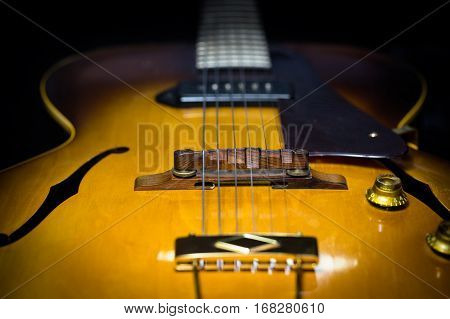 Jazz arch top guitar with a focus on the bridge